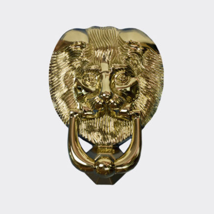 A gold lion door knocker to fit on a Solidor front door