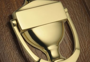 shiny gold door knocker